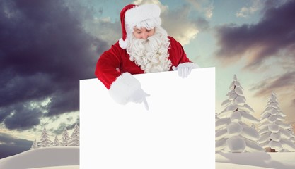Composite image of cheerful santa claus presenting sign