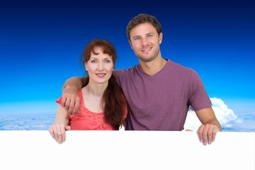 Composite image of couple looking at the camera