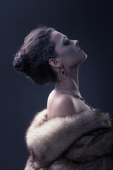 beautiful girl in the image of the Snow Queen in a fur coat