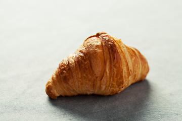 Single croissant on the table
