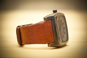 Wrist Watch lie on the table. Vintage style