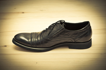 Classic men's shoes. Retro style, photo toned in yellow.