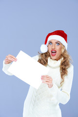 Blond Woman Holding Blank Paper in Surprise Face