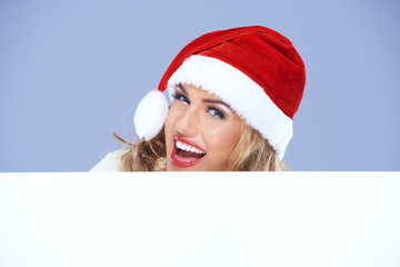 Laughing woman in a Santa hat with sign