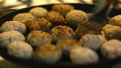 Pork Cutlets fried in oil in a frying pan