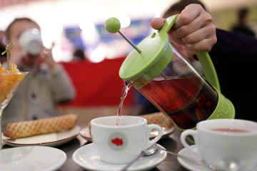 Person pouring fruit tea