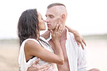 beautiful Couple in love on summer beach
