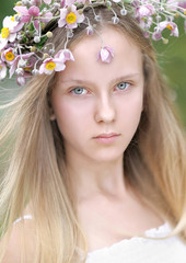 portrait of a beautiful young girl with a bouquet of flowers