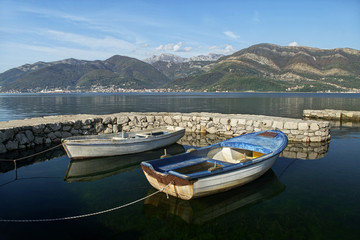 two boats in dock and mountains