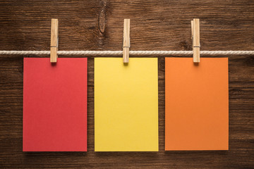 Colorful notes paper on wooden background