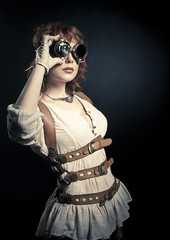 Steampunk woman looking over her goggles