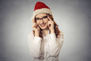 Portrait christmas girl with glasses wearing santa claus clothes