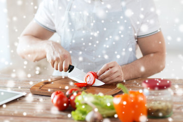 close up of man cutting vegetables with knife