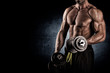 Closeup of a muscular young man lifting weights - 74801147
