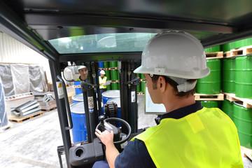 Driver of a forklift in the warehouse // Gabelstaplerfahrer