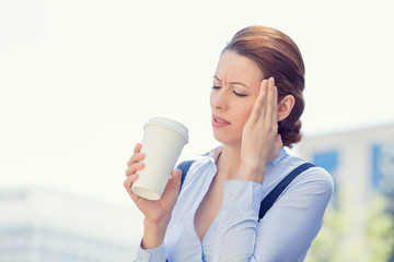 Woman stressed by mistake having headache drinking coffee