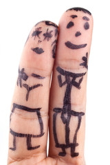 Smileys painted on man's fingers.