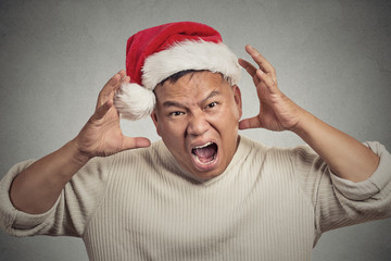 christmas man with red santa claus hat stressed out, yelling
