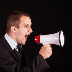 businessman screaming in megaphone