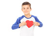 Cute little boy holding a heart