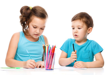 Little children is drawing on white paper