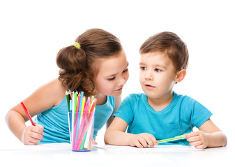 Cute children is drawing on white paper