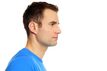 Profile of young man in blue shirt