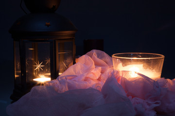 Candles naturmort in dark on pink drape