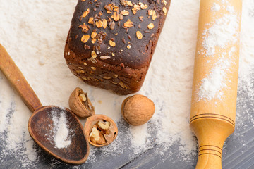 bread, flour, walnuts, spoon, rolling pin on the table
