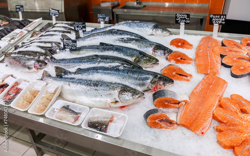 Raw fish ready for sale in the supermarket - 74804337