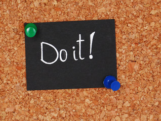 """Motivating paper sheet with inscription """"Do it"""""""