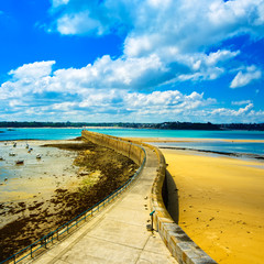 Saint Malo pier or jetty and lighthouse. Brittany, France.