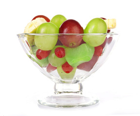 Mix of fruit in glass saucer isolated on white