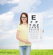 little girl in eyeglasses with eye checking chart