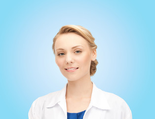 smiling young female doctor over blue background