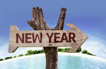 New Year sign with a beach on background