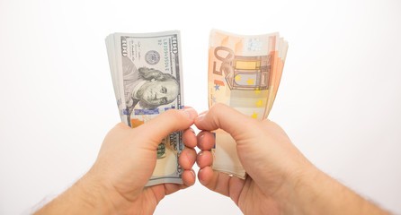 pov two hands holding dollars and euros isolated