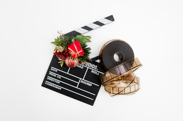 Film reel and clapper board with christmas decoration