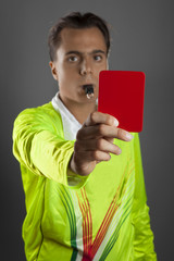 Soccer referee showing the red card isolated on gray background