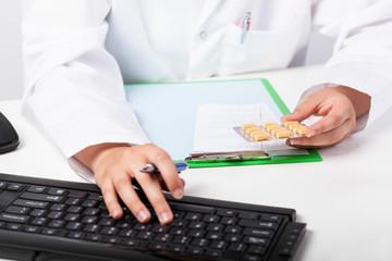 Pharmacist's hands realizing prescription