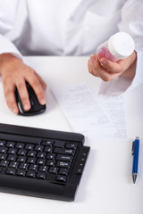 Pharmacist using computer during work