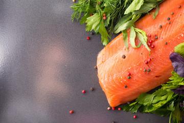 Salmon woth seasoning on a pan