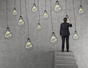 businessman drawing bulb