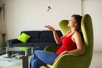 Woman home owner playing with keys of new house on sofa