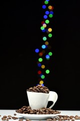 coffee cup and coffee beans with bokeh color effects