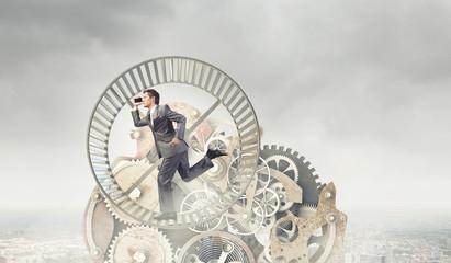 Businessman in wheel
