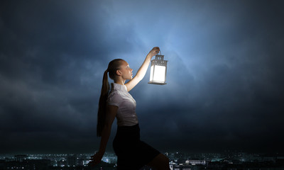 Businesswoman with lantern
