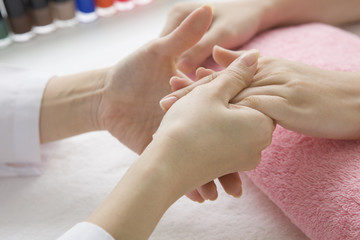 Women receiving a hand massage