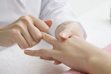 Young women undergoing hand massage