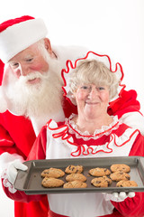 Santa claus and Mrs Santa with cookies